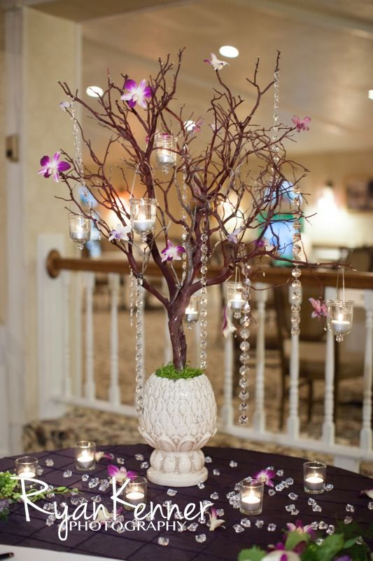 Manzanita centerpiece purple orchids hanging votives