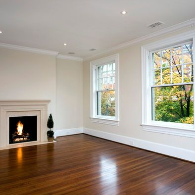 antique white walls, white ceiling and trim, medium wood floor, fireplace...kind of how ours will be!