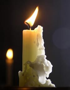 How to remove candle wax from just about anything....From Painted Walls: Place several sheets of paper towels over the wax you want to lift off the wall. Warm your iron to the lowest setting and, working in short intervals, run the iron over the paper towels. The wax should transfer to the paper towels.
