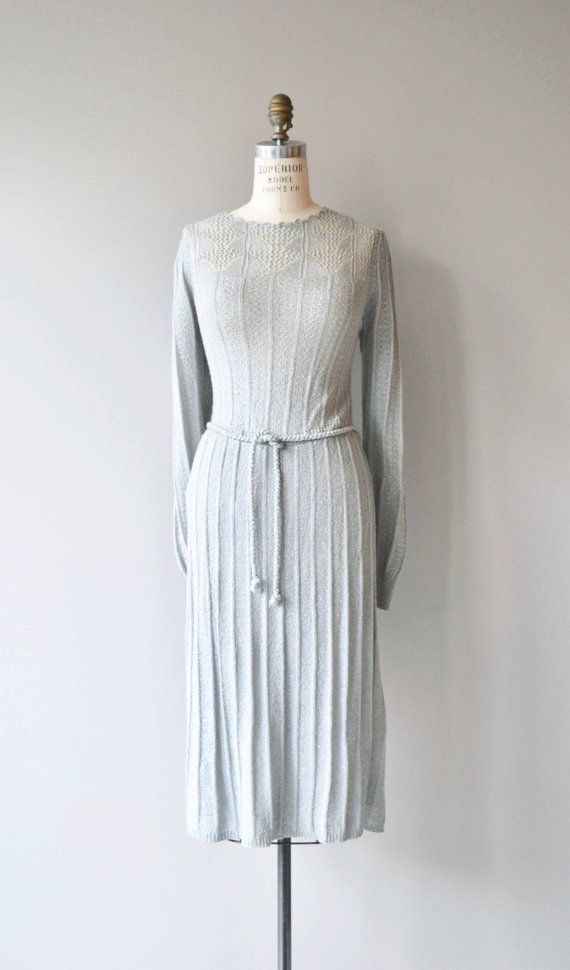 Vintage 1970s soft and washable acrylic knit dress with lovely lace knit neckline, long sleeves with ribbed cuffs, elastic waist with tie belt and no closures, slip on easily over the head.  --- M E A S U R E M E N T S ---  fits like: medium/large shoulder: 16 bust: 34-44 waist: 30-38 hip: up to 50 length: 46 brand/maker: Knit Ability condition: excellent  ✩ layaway is available for this item  To ensure a good fit, please read the sizing guide: http://www.etsy.com/sho...