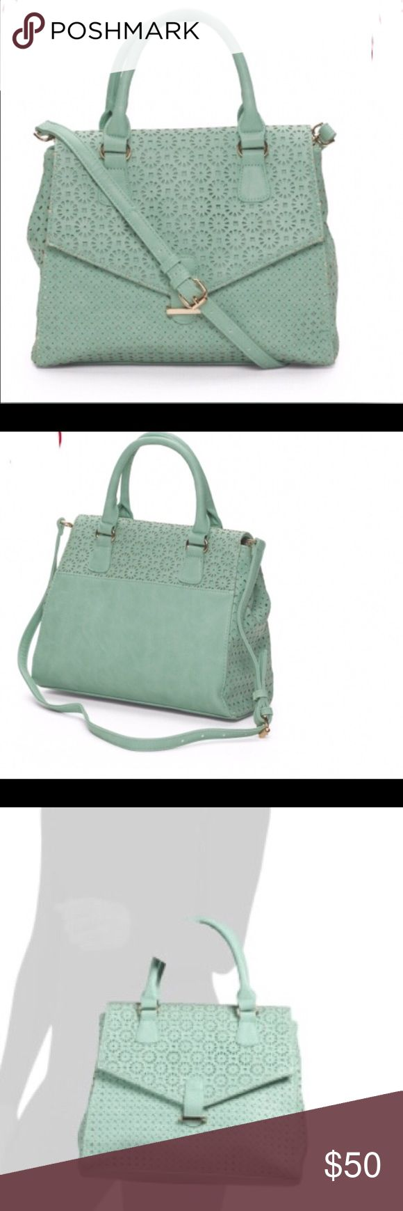 "Perforated satchel Nila  Anthony perforated satchel in mint.  Detatable/adjustable shoulder strap... Convertible style, expandable.....magnetic disc closure...3 interior pockets... Faux leather.....15.5"" W x 10.25"" H...NWT Nila Anthony Bags Satchels"
