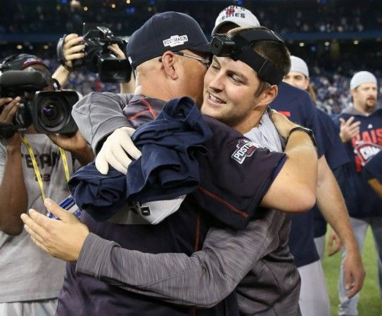 Indians manager Terry Francona and pitcher Trevor Bauer celebrate 3-0 victory in an ALCS playoff game 5 between the Cleveland Indians and the Toronto Blue Jays played at Rogers Center in Toronto on Wed , Oct. 19, 2016. (Thomas Ondrey/The Plain Dealer)