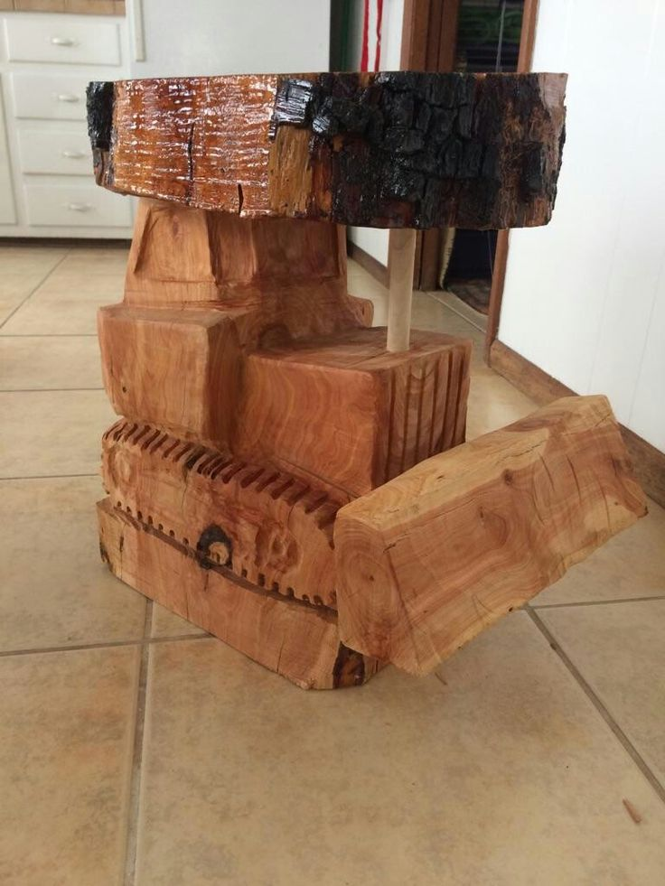 Chain saw art of a Bull dozer table