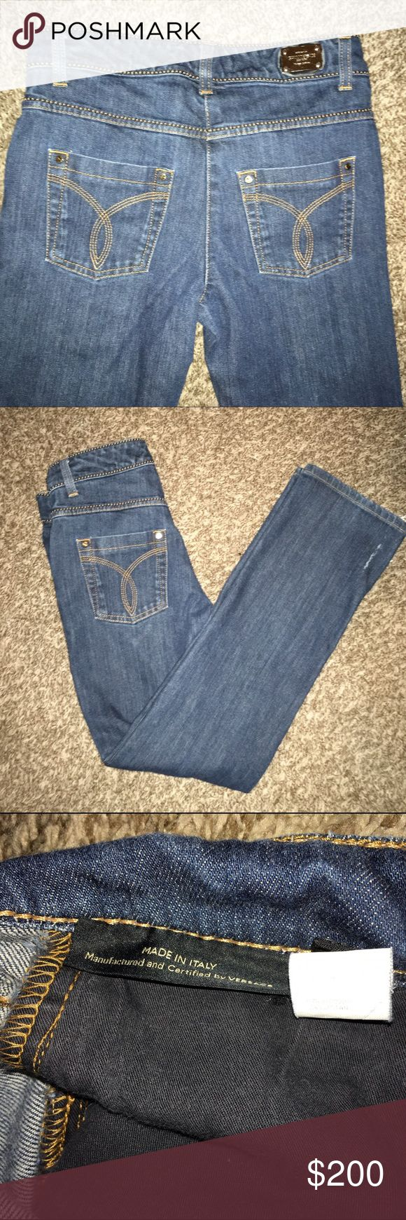 Gianni Versace women's slim boot cut jeans size 26 Like new. Only flaw is the bottom of the pant leg. Looks like a white mark but it's the jeans slightly splitting. Size 26 with gold seam detail. Gold metal plate that reads Gianni Versace. Made in Italy! Versace Jeans Boot Cut