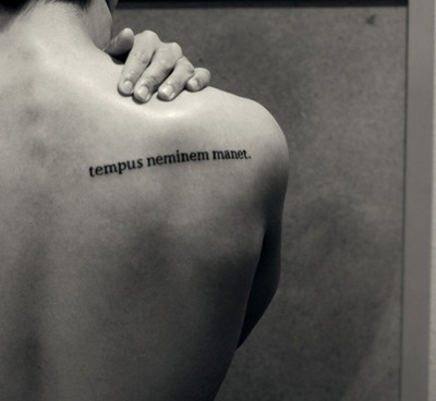 """""""Tempus neminem manet"""" translates to """"time waits for no one"""".It is a reminder to myself that we cannot live our lives in constant fear of the unknown.   I like this quote alot"""