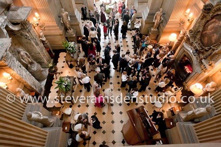 Guests enjoy drinks and canapes in The Great Hall, Castle Howard