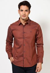 Show off a perfect combination of style and unmatched innovation adorning this brown coloured casual shirt from the house of United Colors of Benetton. This button-down shirt will be a delight for your skin as it is fashioned using quality 100% cotton. For a quintessential utilitarian look, club this slim-fit casual shirt with vintage jeans and leather moccasins.