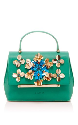 This **Delpozo** mini bo bag is rendered in calf leather and features intricate sequin embellishments in a floral motif.