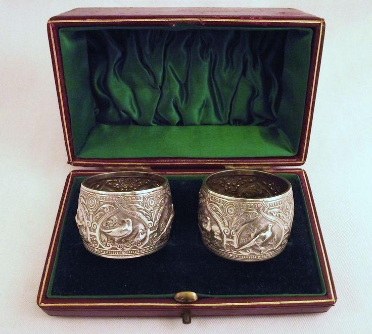 CASED PAIR OF SCOTTISH SILVER NAPKIN RINGS - GLASGOW 1890 GAME BIRD DESIGN