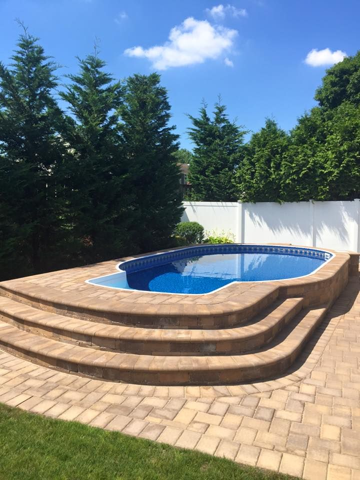 Radiant 12x20 semi inground oval with walk in steps for Walk in swimming pool designs