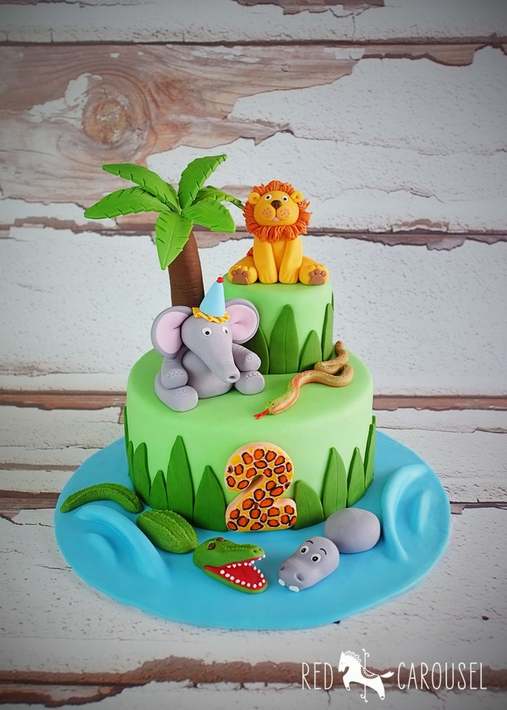 "Cute Jungle Animal Birthday Cake. With fondant Lion, Elephant, Crocodile, Hippo and Snake . Additional pins for this cake... http://www.pinterest.com/pin/374784000213758504/ http://www.pinterest.com/pin/374784000213758477/ http://www.pinterest.com/pin/374784000213758441/  or visit my board ""Jungle Animals cake"""