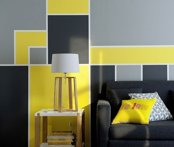 Un salon graphique en gris et jaune