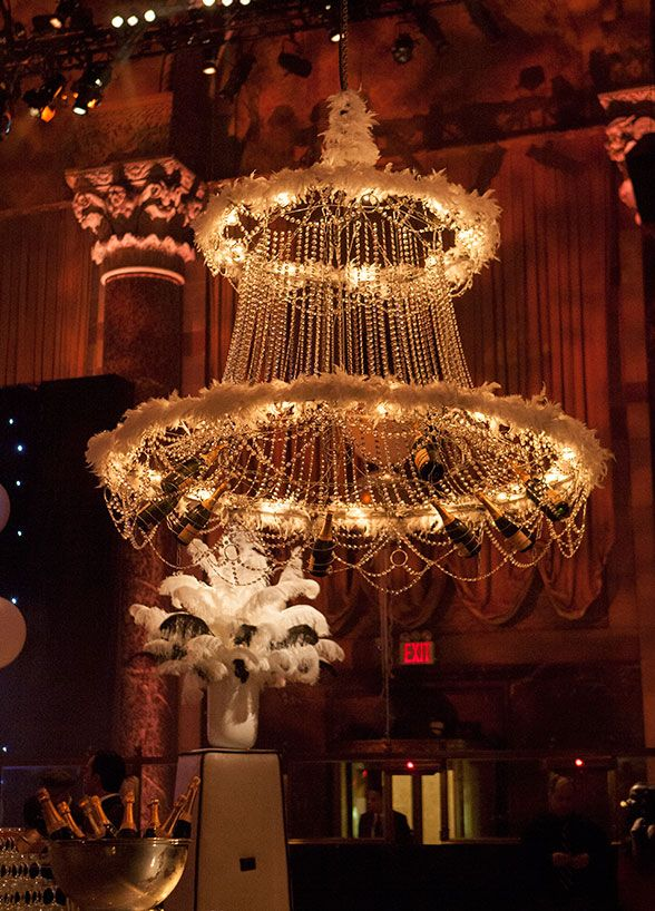 This 1920's inspired flapper swinging from a crystal chandelier kicked the party into high gear. Great Gatsby Inspired Celebration
