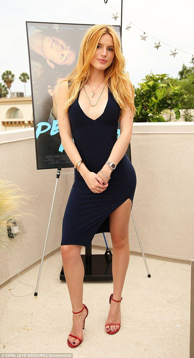 Glammed up: Bella was stylish as ever in a navy dress with an asymmetrical hem at the photocall event