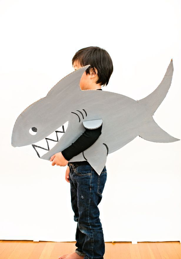 Easy Shark Costume for Kids. A simple cardboard costume idea for kids on Halloween or fun pretend play.