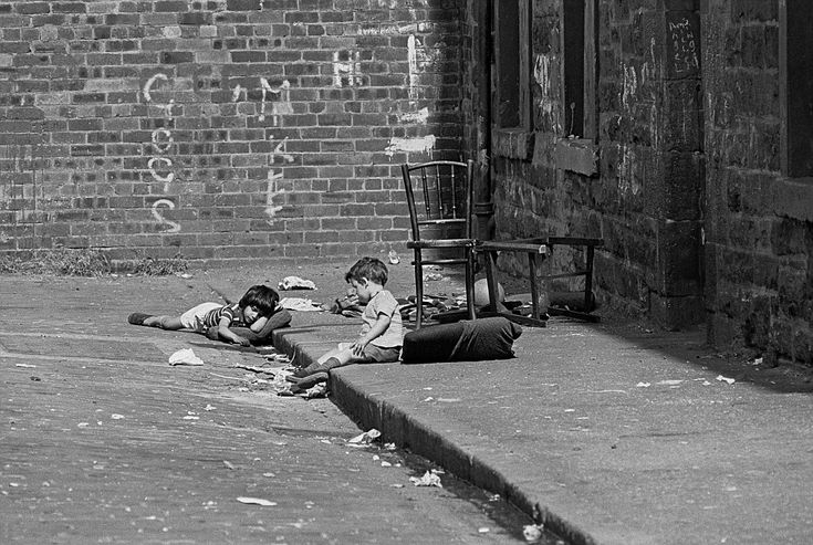 Poverty: Two children are pictured playing in the street by Leith tenement in Edinburgh in...