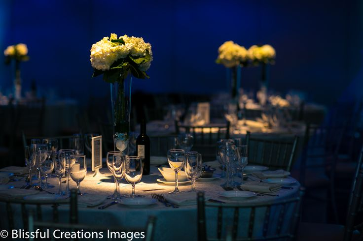 tall flower centrepieces with white flowers