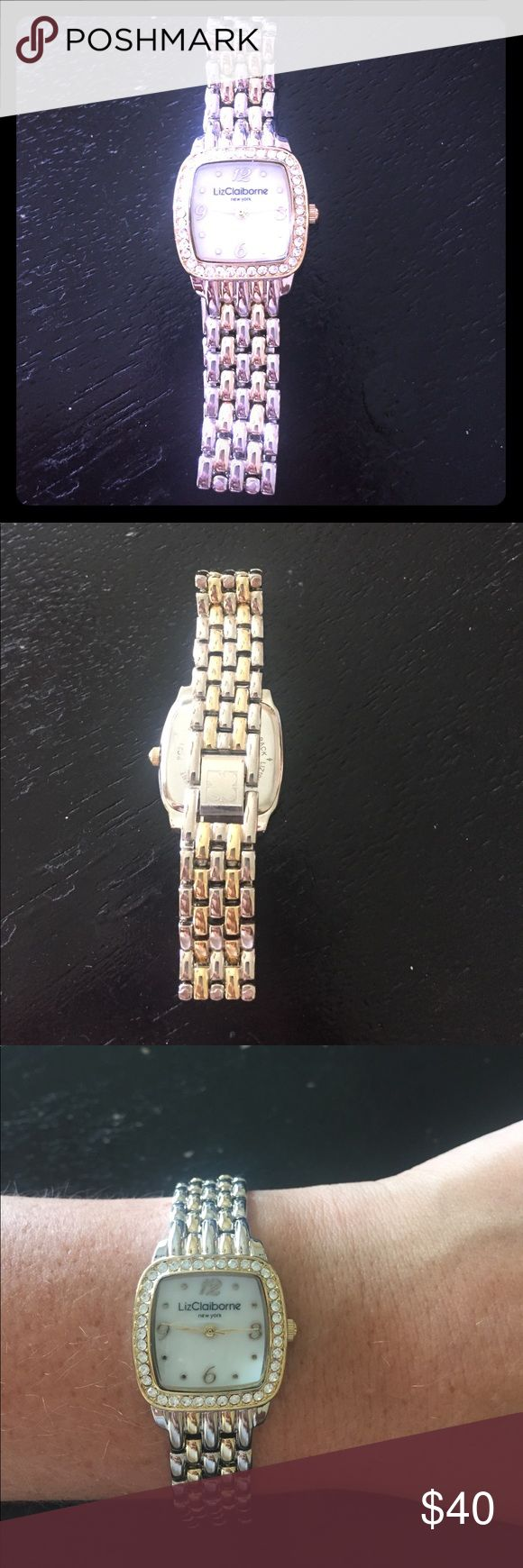 Liz Claiborne gold and silver watch. Price drop! I've worn this watch once! It's very light and dainty! It does need a new battery! Goes with anything! Liz Claiborne Accessories Watches