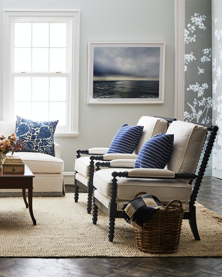 Classic coastal living room with blue and white patterned accents and plenty of natural fiber finishes.