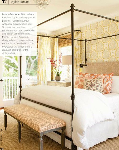 Iron Canopy Bed Paired With Wallpaper Behind