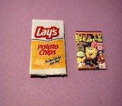 Miniature potato chips sack with magazine.