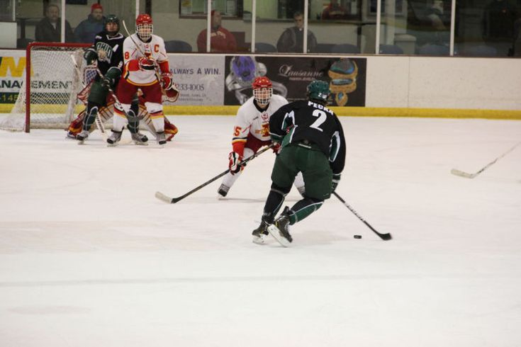 Ohio defense's TYLER PECKA attempts to pass ISU forward David Kurbatsky to make a shot during the game Jan. 12, 2013, at Ames/ISU Ice Arena. The Cyclones couldn't hold off the Bobcats, as they did in Friday's overtime thriller, and ended with a final score of 8-5.