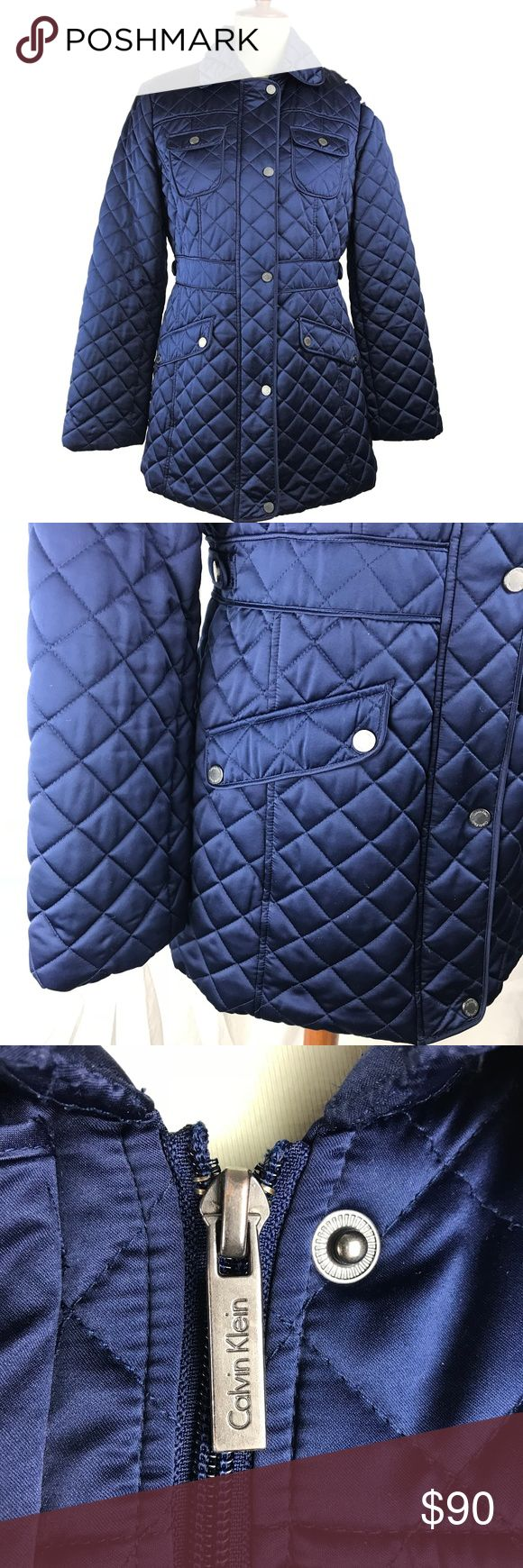 "Calvin Klein Navy Blue Hooded Quilted Coat Stylish and warm quilted hooded winter coat in excellent condition.  Side button-tabs and defined back waist refine the silhouette. Removable hood. Two chest pockets and two large pockets in front. 31"" length (size Medium). Front zip closure with outer snap placket. Chest buttoned pocket; front pockets. Fully lined (faux fur trim in the hood and upper body) 100% polyester with 100% polyester faux fur trim. Machine wash cold, tumble dry low. Calvin…"