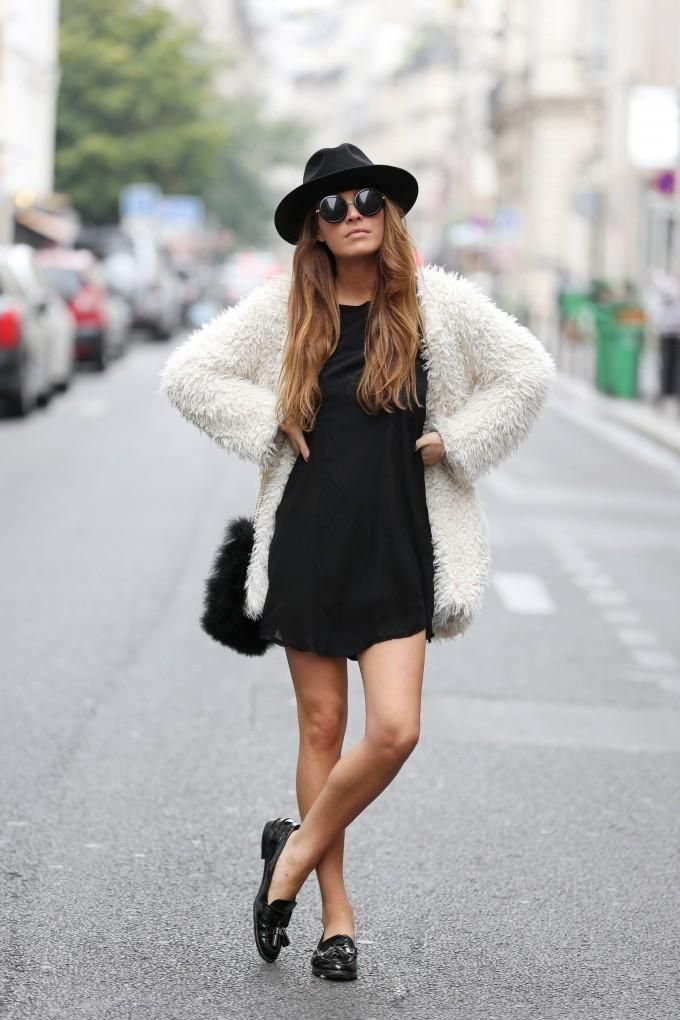 Felt hat with fuzzy coat and simple black dress.