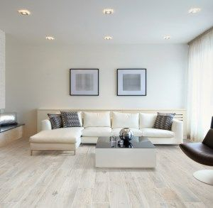 Our white oak Memory Bianco wood effect porcelain floor tiles perfectly compliment the cool tones of this contemporary lounge. #OakEffectTiles #BeswickStone #PorcelainFloorTiles