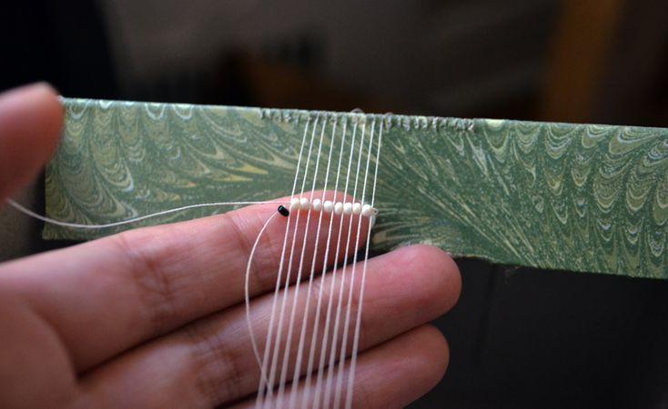 DIY bead loom made from a kleenex box