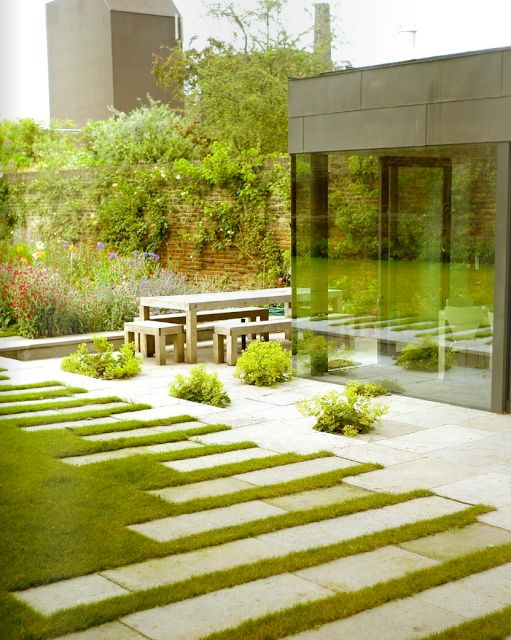 I love how the paving blocks moderate the line between grass and patio