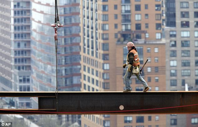 True Grit: America's daring ironworkers walk the girders just like their forefathers as they rebuild at Ground Zero