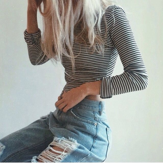 High waist boyfriend distressed jeans with black and white striped long sleeved cropped top