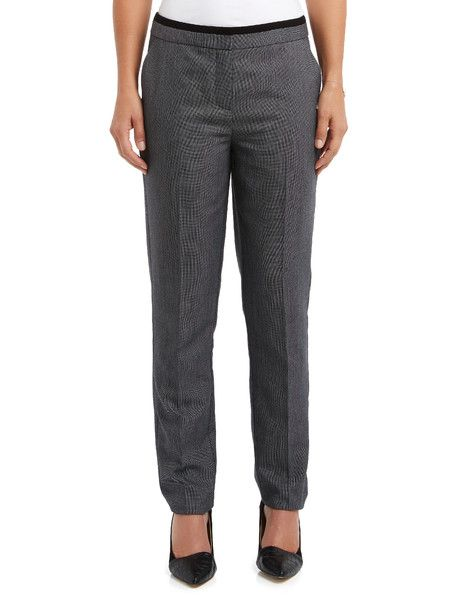A pair of regular length pants with front zip detail and black contrast around the waistband.