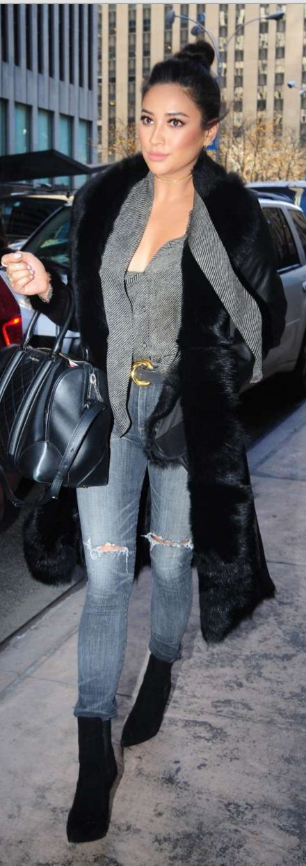 Who made Shay Mitchell's black coat, leather handbag, suede ankle boots, gray print shirt, and blue ripped jeans?