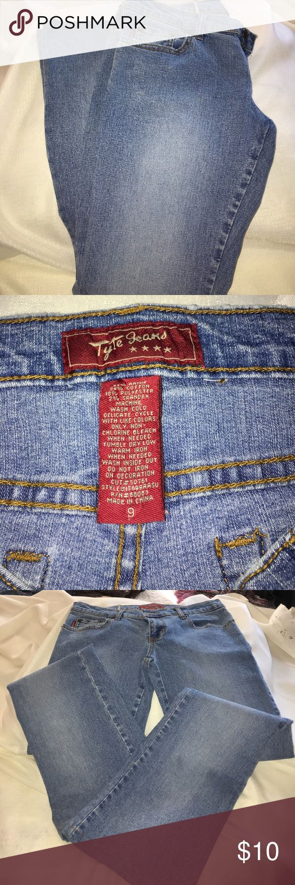 """True Jeans Brand logo blue jeans. Nice washed look blue jeans  soft. Front pockets. 2 back pockets nice embroidered heart designs with crystal embellishment.  Nice condition. Size 9   Cotton polyester and spandex. Inseam approximately 29"""". TYTE JEANS Jeans Straight Leg"""
