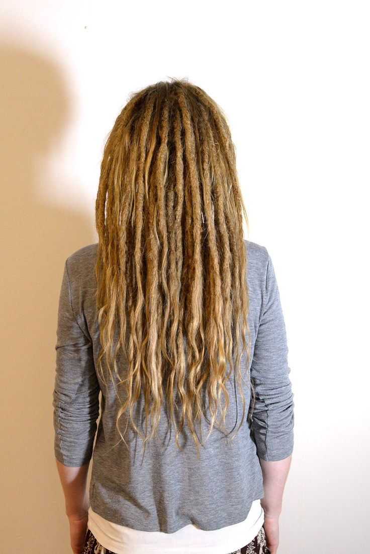 This is Veronika, she came to me to start her dreadlock journey. I made dreadlocks on her own hair and extended them with human hair.  It's amazing to be able to vitness my clients transformation.