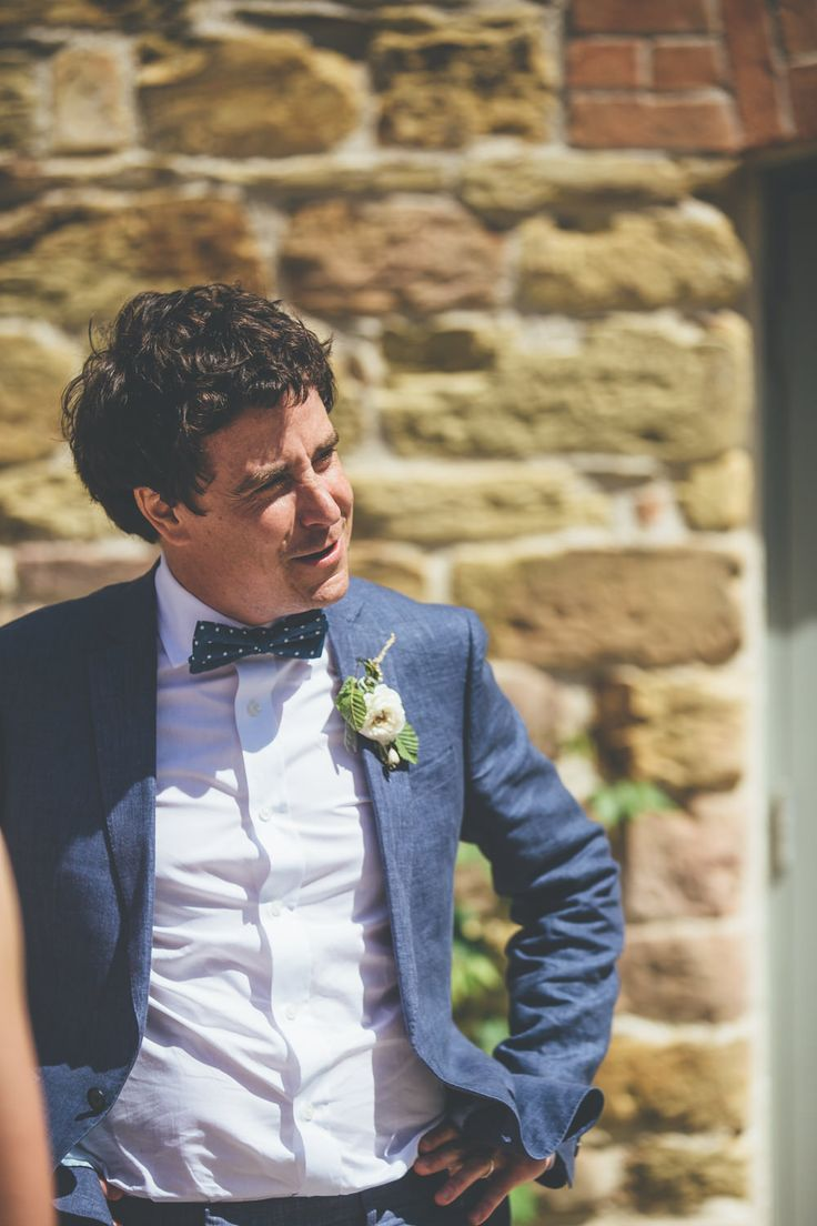 Groom wears a lightweight pale blue linen suit from French Connection with a bow tie -   Ross Talling - Rustic Barn Wedding At Nancarrow Barn In Cornwall With Bride In Mori Lee Gown With A Flo And Percy Headpiece With Groom In Navy French Connection Suit And Bridesmaids In Nude Dresses From Debenhams Images From Ross Talling