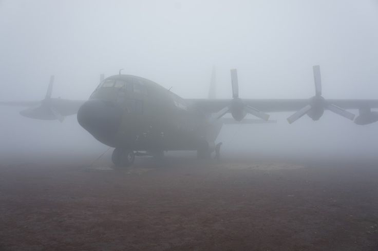A B-52 at Khe Sanh Combat Base on an extremely foggy winter day.  A C130, not B52. Thanks to mike romaine for that info!