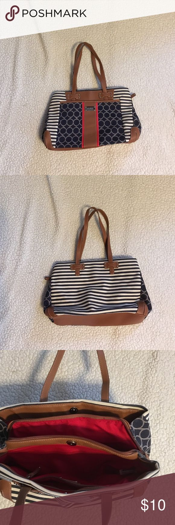 """Nine West Purse Multiple Compartments Medium Size Nine West double handle purse. The purse is used but in very good condition. Navy blue and white with brown trim. Purse measures 13 x 9 x 4"""". Nine West Bags Satchels"""