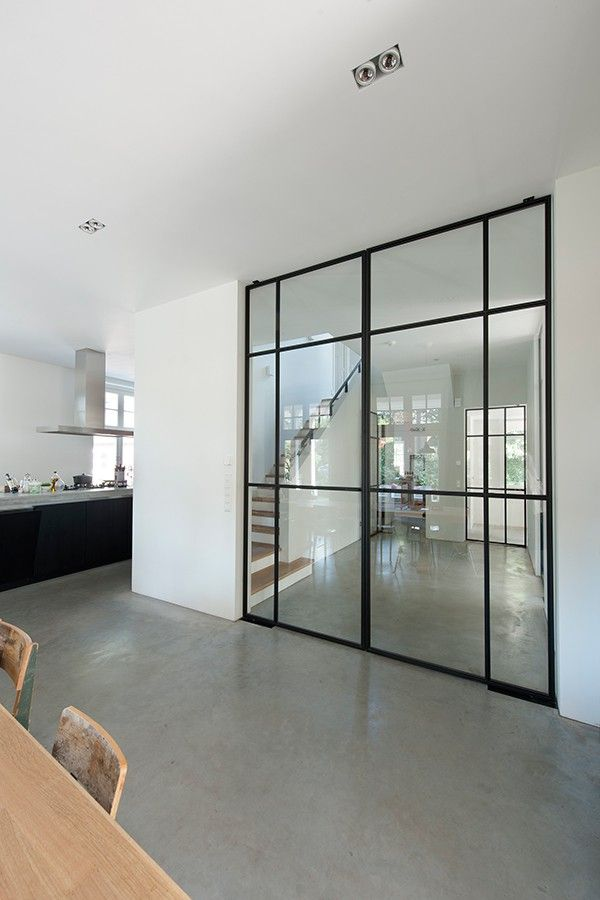 Walls of glass and steel instead of bricks. And they can even function as doors. I love it. Giving extra light and the feeling of one space. Apparently this is a vila in Bussum by Vocus. #architecture #living #steeldoors