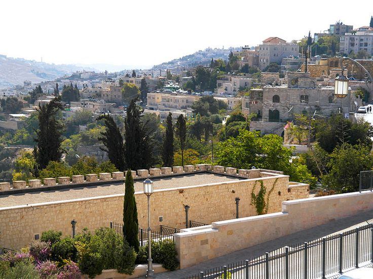 Jerusalem, Israel - Scenic View, looking east from the bridge near Saint Andrew's Scottish Guesthouse. Mishkenot Sha'ananim (משכנות שאננים) in the foreground. Mount Zion Hotel (showing the cable car) at right