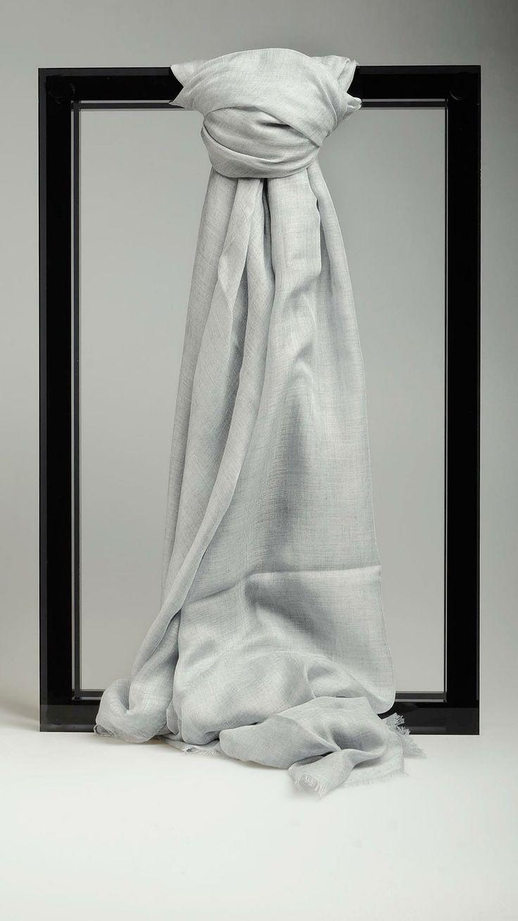 Plain grey raw cut scarf featuring 77.2'' x 55.1'', 90% modal 10% cashmere.