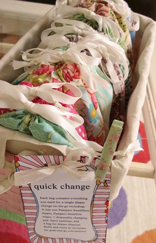 WHY DIDNT I THINK OF THIS?! quick change baby shower gift How cute! Just grab a bag and go; its already loaded with diaper, wipes, and sanitizer. Brilliant idea! Id add a clean onesie to each.