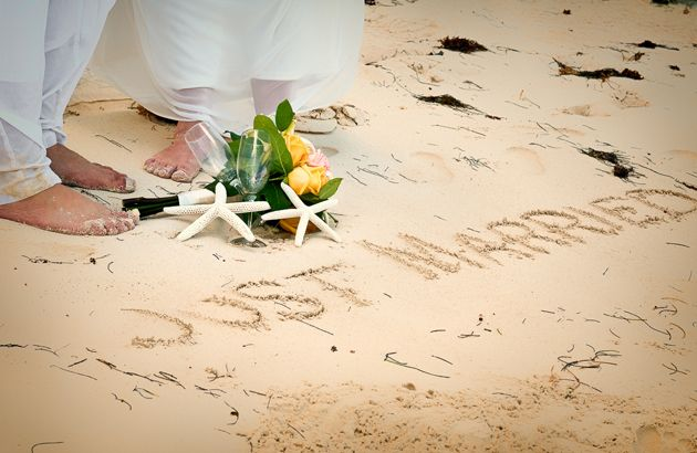 Beach Wedding Photography Idea: Write Just Married in the Sand and show off your pedicure!