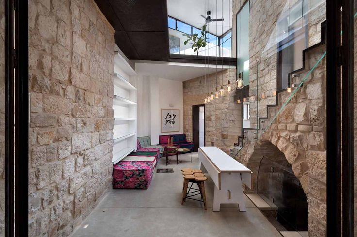 This historic home by Henkin Shavit Architecture is reimagined through a modern lens.