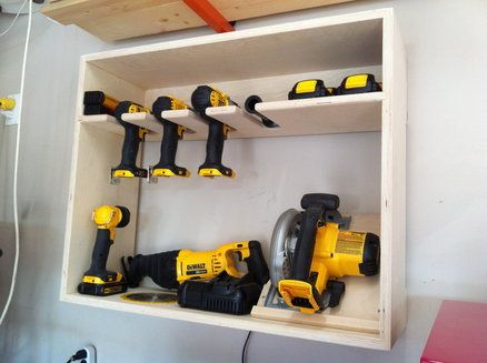 Cordless power tool storage station - a DIY project. How I would love to have all these tools, and the need to sop tore them!!