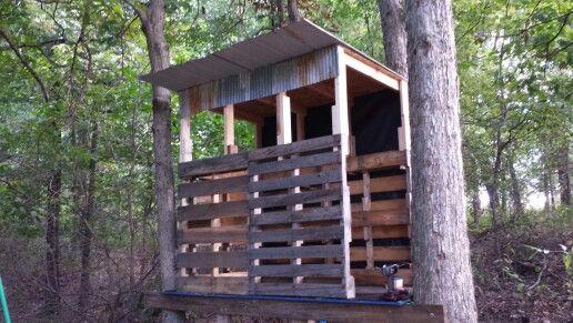 Deer blind made using old pallets and repurposed barn for Wood deer blinds