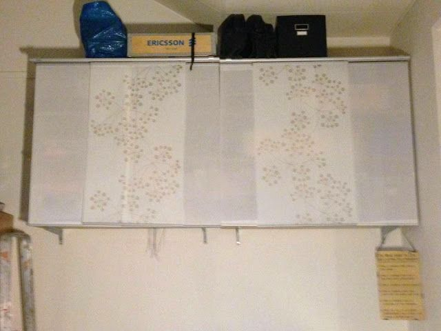 IKEA Hackers: Hide Wallmounted Bookshelf With Ikea Panel Curtains