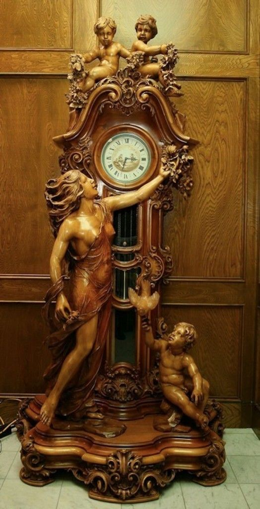 I love this clock I saw so many, in Italy and Europe. They are so expensive. This clock stands at just over 8 feet tall and is of course hand carved and the choice of wood is walnut.